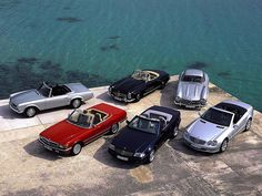 https://flic.kr/p/9VV41P | Mercedes-Benz SL History 1954-2004 | From left to right: Mercedes-Benz W113, R107, W198 II, R129, W198, R230