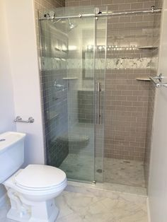 Master Bath Remodel by BlankSpace LLC, Pittsburgh PA. Walk-in Shower with Custom Tile Surround featuring Dove Gray Ceramic Subway Tile and Calacatta Diamond Marble Trim; Frameless Sliding Glass Door; Custom Shower Base with Marble Subway Tile and Threshold