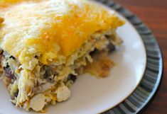 Easy, Cheesy Green Chile Chicken Enchilada Casserole — Not only is it easy to make, but it's loaded with cheesy goodness and a nice bit of sour cream! Via @Karen Merzenich