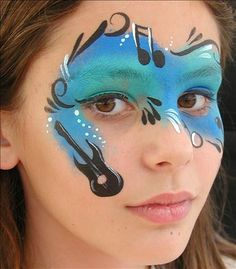 Face Painting. Love this except that I would need to change the direction the music notes are facing.