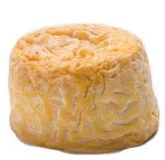 Langres is a French cheese from the plateau of Langres in the region of Champagne-Ardenne. It has benefited from an Appellation d'origine contrôlée (AOC) since 1991. Langres is a cow's milk cheese, cylindrical in shape, weighing about 180g. The central pâte is soft, creamy in colour, and slightly crumbly, and is surrounded by a white penicillium candidum rind. It is a less pungent cheese than Époisses de Bourgogne, its local competition.