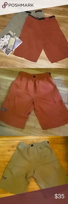 prAna Mens Shorts prAna mens shorts. One pair is an olive green color and the other pair is a burnt orange color. They are both stretch and they clip together at the waist to adjust the size. Both in excellent condition. They are both size small. prAna Shorts Cargos