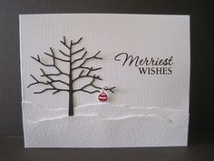 White snowy hills and a brown twig tree with a single red ornament help this handmade Christmas card bring the simplest of happy wishes.
