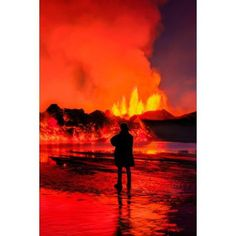 Woman watching the lava flow at the Holuhraun Fissure eruption near Bardarbunga Volcano Iceland Canvas Art - Panoramic Images (27 x 9)
