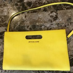Michael Kors Tilda clutch Great pop of color in a bright yellow!  inner pocket and zipper. 6 card slots. Excellent condition. Like New. % Authentic. Plastic tag inside just hard to get a good picture of it. MICHAEL Michael Kors Bags Clutches & Wristlets