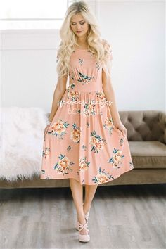 This beautiful floral dress will be your new favorite, you will grab for it again and again! Beautiful peach dress features a yellow peony floral print, short sleeves and flattering waist band.