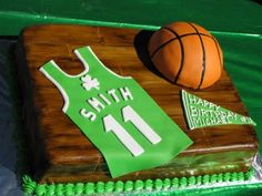 This is a double layer 1/2 sheet cake. It is entirely edible and comes complete with a hand-painted hardwood floor! #celtics #baking #cakes