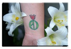 Next Tattoo: Parkinson's Disease Tulip and then making left side become a purple ribbon for Alzheimer's. Honoring both Grandmas with one tattoo!