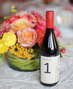 Love this idea. Wine bottles for table numbers.