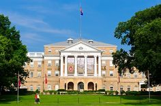 Banners celebrating 100 years of the Wisconsin Idea hang from Bascom Hall.