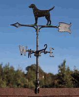 """The dog weathervane is available in rooftop or garden style and is available in two colors and in Lab, Golden Retriever and German Shepherd. Rooftop Dimensions: 15.5"""" x 23.5"""" x 30.5"""" $85. Garden Dimensions: 16.625"""" x 12.25"""" plus 5' Stake.  $65.  Made of recycled aluminum rustproof."""