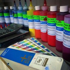 We love being #surrounded in #color all day everyday. #superiorink #colorful #rainbow #ink #screenprinting #printing
