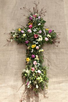 A willow cross decorated with spring flowers. This could easily be made to be used in a natural burial ground. No floral foam was used. All British flowers and foliage. Snow drops from the lady's garden were dug up and placed within the tribute. Funeral Flower Arrangements, Church Flower Arrangements, Church Flowers, Funeral Flowers, Unique Flowers, Fresh Flowers, Spring Flowers, Flower Patch, My Flower