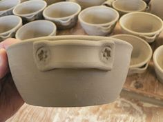 by Eleanor Hendriks I was busy in the studio today putting handles on these...  ...with little stamps like this...  ..when I realized that i...