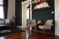 Beautiful living area -- i like the idea of a little sitting area and shelving unit.