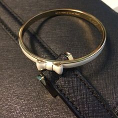 Kate Spade bracelet Kate Spade bracelet. Very cute and chic with white/ivory plated in the outside and a bow on top. Only used once for a wedding  reasonable offers are welcome kate spade Jewelry Bracelets