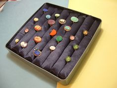 Eco-friendly ring display  --  These are easy to make.  Stuffed velvet tubes on a box. I made one years ago by wrapping the velvet around somethong and glueing it..  I don't remember what though....