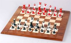 This Art Deco Chess Set really is an amazing Masterpiece. The porcelain-like, unique Art-Deco styled chessmen bring vivacious cheer and lighthearted holiday accents in red and black with faux pearl inlay. A mid-size set of chess men with 3 1/2″ tall king piece.  Specifications: King size: 3-1/2″ Base size: 1-3/8″