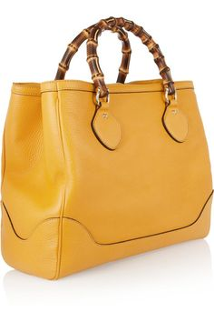 Sunshine-yellow textured-leather Two bamboo top handles Feet, gold hardware Two open compartments, zip-fastening central compartment, zip-fastening pouch pocket, pouch pockets Fully lined Snap-fastening tab at top This style is made from natural bamboo and as such may have small indentations