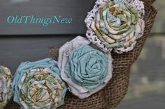 Rosette Wreath Tutorial -- So, as promised in my last post, SpringDreamin', I'm back with a tutorial for one of my Spring decorating projects. This is my DIY Rosette Wreath made from leftover fabrics, including drop cloth material, vintage lace, burlap, and solid and floral cotton. ~ Old Things New