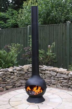 Extra large steel chimenea with large modern chimney funnel. The extra long chimney will help prevent smoke in your garden from the fire. The chimenea is ultra modern and will be a fantastic garden centrepiece. This chimenea comes complete with charcoal grill and has a cast iron base.Steel will rust over time but can be repainted and will not affect the use.