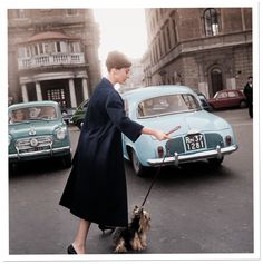 Audrey Hepburn and Mr. Famous leave the Hotel Hassler, on the Piazza Trinità dei Monti, 1960. © ARCHIVIO STORICO LUCE; DIGITAL COLORIZATION BY LORNA CLARK.
