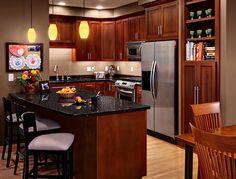 Cherry wood cabinets with dark granite