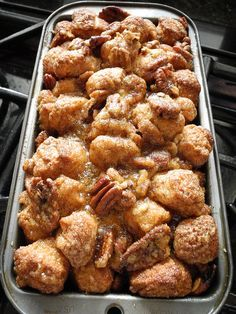 Monkey Bread - 2 cans biscuits, cut into quarters. Shake in a baggie with cinnamon sugar. Place into bread pan coated with non-stick spray. Melt 1/2 stick butter 1 cup brown sugar over low heat, stirring so it doesn't burn. Pour over bread bake for 20-30 minutes. Put half pecan pieces on the bread bites before pouring brown sugar mixture over the top.