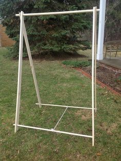 Step-by-step directions and photos to make a very simple wooden clothing rack for less than $40 from everyday materials at your local home improvement store. Very easy and breaksdown for quick transport.