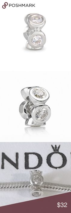 Pandora Clear CZ lights Spacer Charm Authentic Pandora charm. Pandora Clear CZ lights Spacer Charm. Sterling silver charm with clear cubic zirconium stones around it. Stamped with 925 Ale on the side.   Bundle to save!  *Does not include the bracelet or cloth, sorry I do not have the box*  #Pandora Spacer Charm, Pandora sparkly charm, Pandora CZ charm, Pandora cubic zirconium charm, Pandora Christmas charm, Pandora gift Pandora Jewelry Bracelets