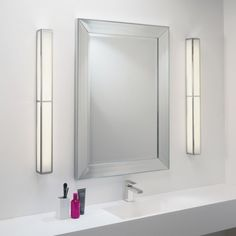 The Mashiko 900 Bath Bar has a far-eastern influenced design that gives it character and style. Ideal for fitting either side of bathroom mirrors, this wall light has a polished chrome finish and a boxed, angular design.