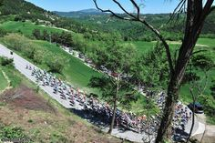 The peloton working its way of the first of two categorized climbs, Colle Galluccio, Giro d'Italia 2012