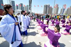A group of 15 year old girls from Taiyuan participate in a traditional Chinese coming of age ceremony where they receive a hairpin to symbolize becoming an adult. This ceremony was part of the 2nd Shanxi Radio and TV Carnival in China.