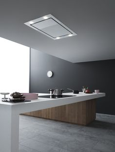 Falmec's 'Sirio' remote controlled ceiling extractor with LED lighting. by Kitchen Partners