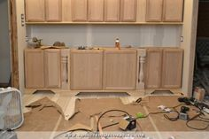 """Make your own decorative feet for stock cabinets - 1; to cover the """"hole area around vent? maybe - i think the other pin is easy, clean, simple way...."""