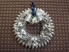 silver christmas decoration wreath with pasta.