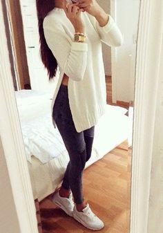 Full right-side shot of model in beige side slit tunic sweater