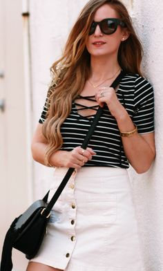 Lace up top and button up skirt styled with lace up gladiator sandals and fringe bag for an easy weekend outfit