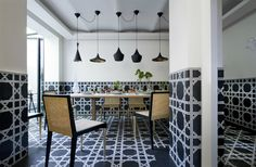 """Jorge Varela - Tom Dixon """"Beat Light"""" pendant lamps, black and white mosaic tile floor and wainscot Cafe Interior, Interior Design, White Mosaic Tiles, Black And White Tiles, Black White, Decorative Tile, Room Accessories, Dining Area, Dining Rooms"""