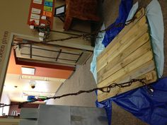 Drawbridge- made from spare wood from a pallet and rope. Table cloths as water. Kingdom Rock VBS - Connection Church, Medina, Ohio