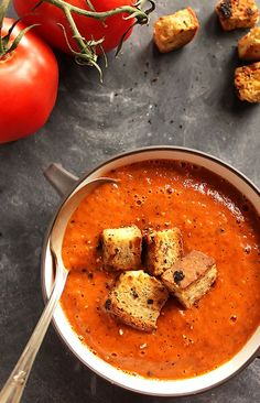 Healing Roasted Tomato and Red Pepper Soup - Creamy soup bursting with tomatoes, roasted red peppers, onion, and garlic. This recipe is EASY to make! We LOVE this soup in the fall/winter. Vegan/Gluten free   robustrecipes.com