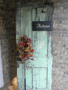 Old doors make great pieces for decorating.  this one has simple sign, old pitch fork and autumn leaves.  You could change out the sign with a cute valentines sign or heart, etc
