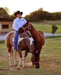 guys always look ten times better on a horse