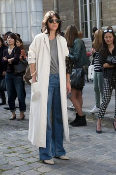 Très Chic! The Best Street Snaps at Paris Fashion Week: The modern woman's take on ladies-who-lunch attire.: A classic trench to top a '90s-feeling slip dress.  : Easy does it in a white coat and jeans.  : Giovanna Battaglia dresses down an LBD with leopard-print flats.  : Easy does it in a white coat and jeans.