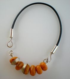 Amber necklace. It would be so great to have a neckpiece like this, and then made a bunch of interchangeable necklaces to  suspend from it. They could even vary greatly in length. Cool!