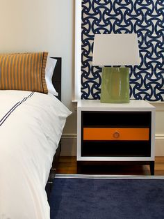 I like the Roman shade maybe do a grey or black with white. And love the night stand maybe do a people stripe instead of Orange