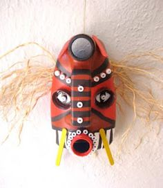 recycled African masks using laundry soap bottles and other recycled materials