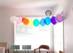 Simple Balloon Banner - Needle & thread; add marbles in each balloon to get them to hang well.  Looks so pretty in front of the window!