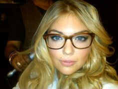 Kate Upton looking marvelous in Tom Ford glasses.  www.ibtimes.com