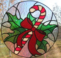 Celebrate the holiday season with this piece of festive stained glass. Bright colors meet with an iridescent background glass that provides an